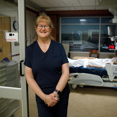 Photo of Lynn Kelso in teaching simulation center
