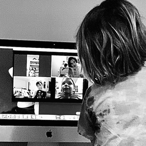 black and white photo of child on Zoom