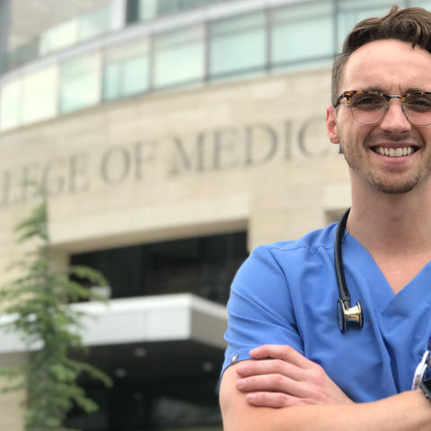 Aaron Gillette in front of the University of Oklahoma College of Medicine