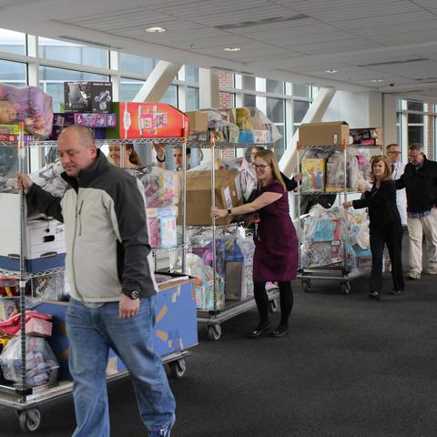 Members of the Ard family and staff from Kentucky Children's Hospital transport the donations collected in Jon's memory.