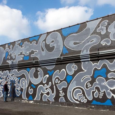 photo of Ben Darlington looking at Carson's mural