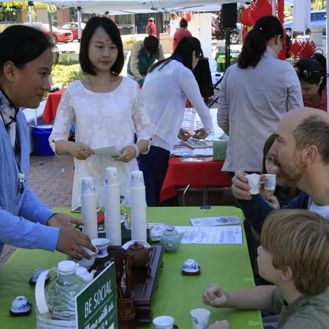 photo of father and son at 2017 Confucius Institute Day booth