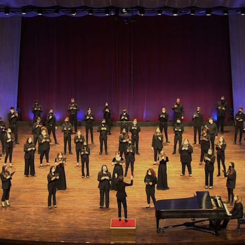 "Photo of UK Choristers physically distanced on Singletary Center stage performing for virtual ""Collage"""