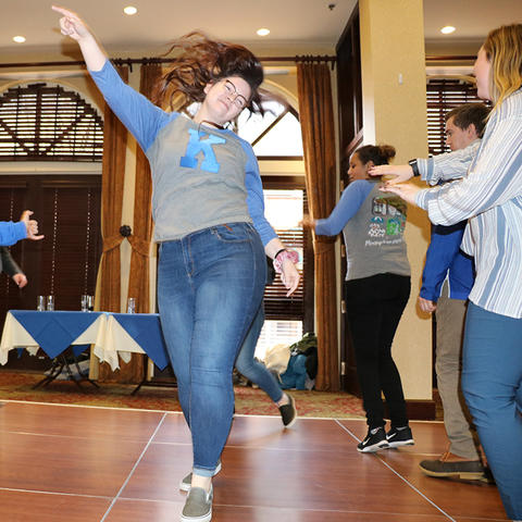 photo of staff dancing at DanceBlue Faculty & Staff party