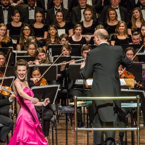 photo of vocalist performing before UK orchestra and choirs at Bernstein concert