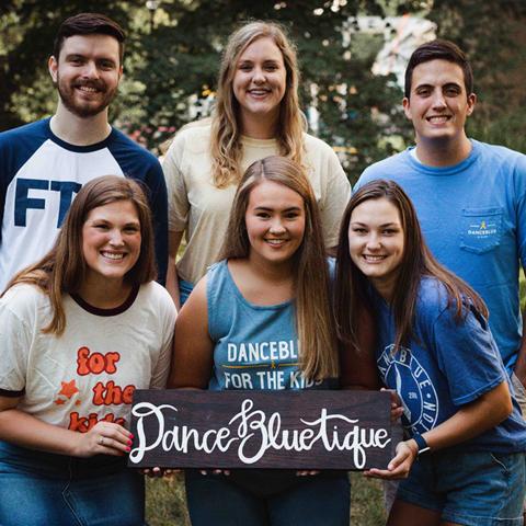 Five DanceBlue students in DanceBlue apparel