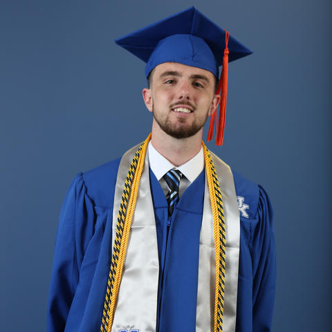 photo headshot of Dillon Pulliam in graduation cap and gown