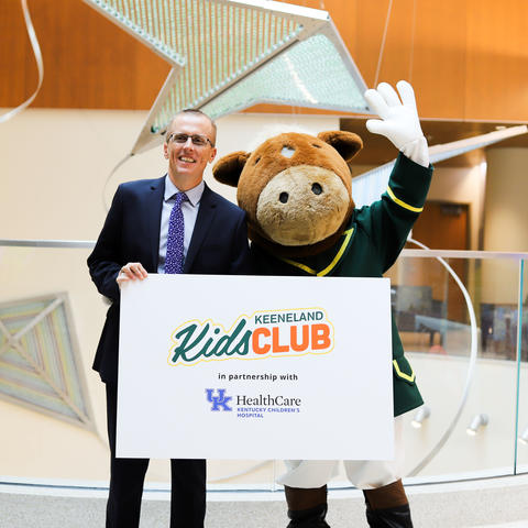 image of Dr. Scottie Day, and Buckles, the costumed mascot of the Keeneland Kids Club