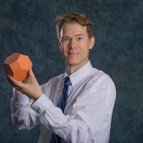 photo of Richard Ehrenborg with a polyhedron