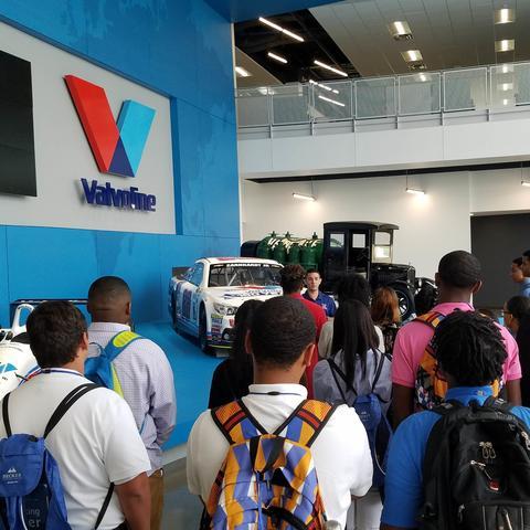 photo of students from FASTrack program listening to Valvoline speaker