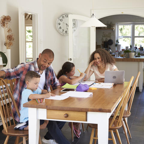 photo of family doing homework at the table