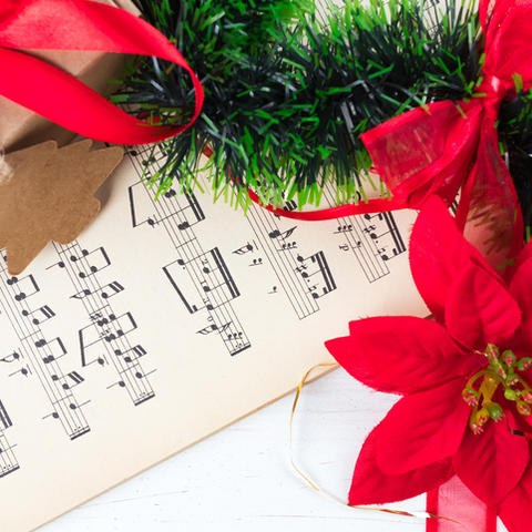sheet music and poinsettias