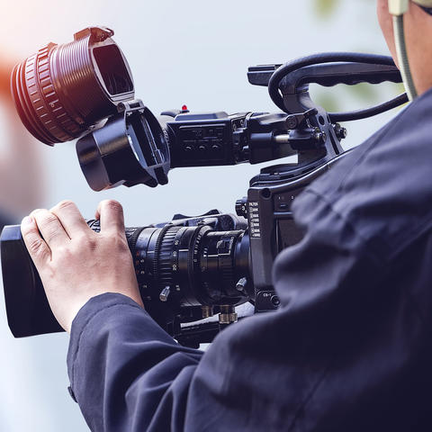 Getty Image of Photographer with TV Camera
