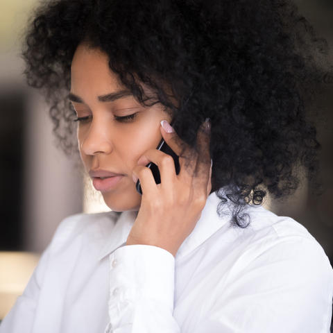 photo of woman talking on cell phone
