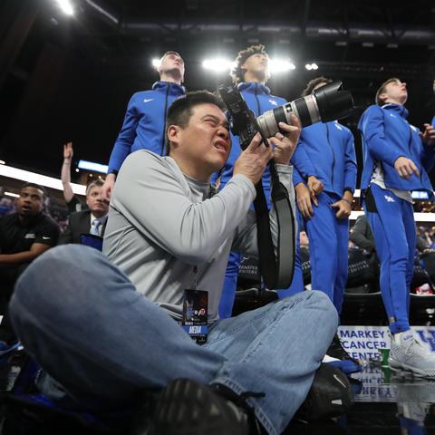 Michael Huang capturing photos at the UK  men's basketball game vs. Utah at the T-Mobile Arena in Las Vegas on Dec. 18, 2019.