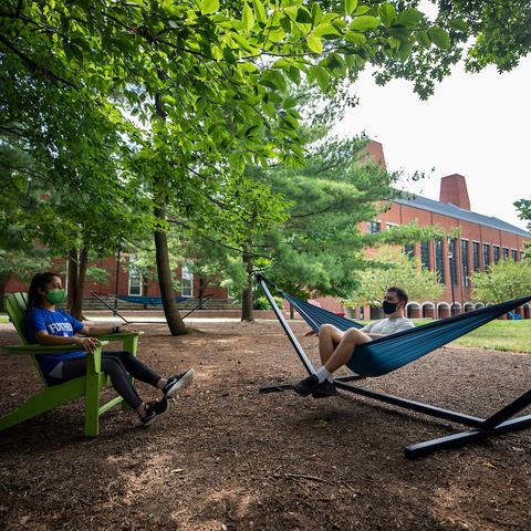 students enjoying one of the hammock gardens on campus