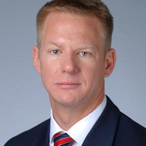 Man in navy suit