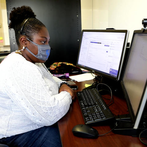 UK Health Corps contact tracer Maya Cleveland at desk
