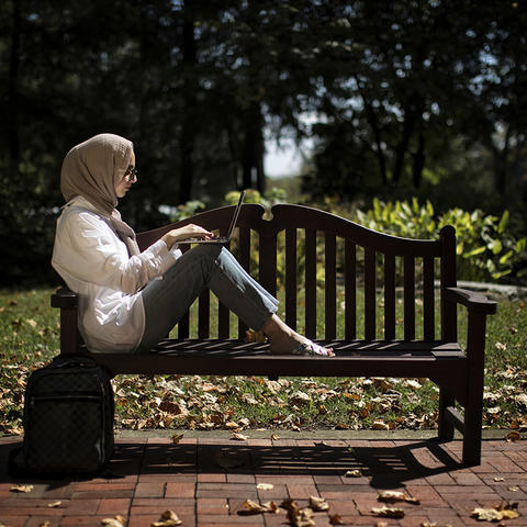Photo of Student Sitting on a Bench
