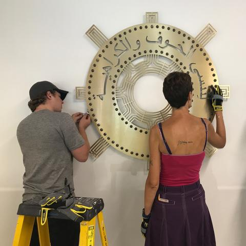 "photo of installation of ""Unlearn Fear + Hate"" sculpture by Kremena Todorova and Kurt Gohde"