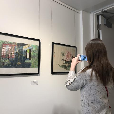 "photo of visitor taking picture of ""In My View"" art"