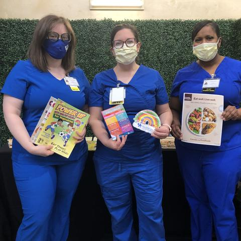Nursing students with health promotion materials