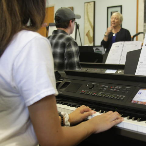 photo of students playing on new keyboards in Vicky McVay class