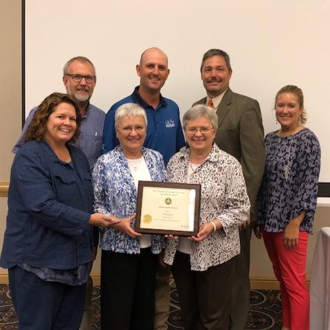 Photo of Dr. Deborah Reed receiving award