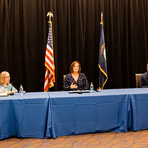 photo of RETAIN news conference speakers left to right: Human Development Institute Executive Director Kathy Sheppard-Jones; Lt. Gov. Jacqueline Coleman; and UK President Eli Capilouto sitting in front of mics at a table