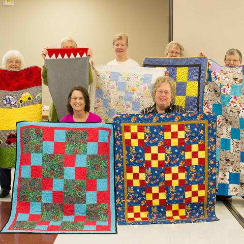 The Bluegrass chapter of Quilts for Kids present some of the quilts they have made