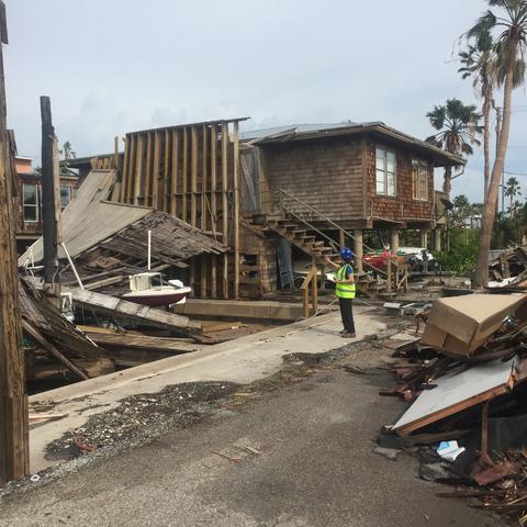 Photo of Mariantonieta Gutierrez Soto surveying damage