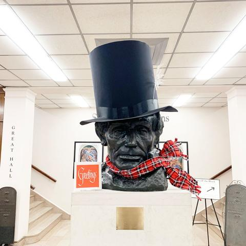 photo of Abe Lincoln bust in King Library with scarf and stovetop hat