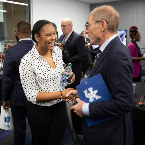 UK President Eli Capilouto greets UK senior Kamaria Campbell at the Martin Luther King Center Opening