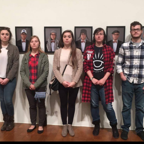 """photo of operations team from """"Art Entrepreneurship"""" class with portraits from """"Saving Myself"""" by Louis Zoellar Bickett"""