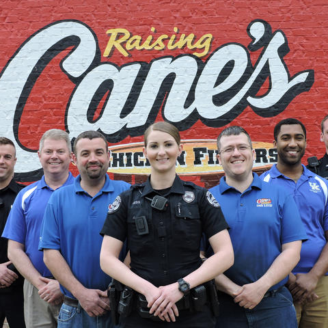 photo of UK Police officers and Raising Cane's personnel