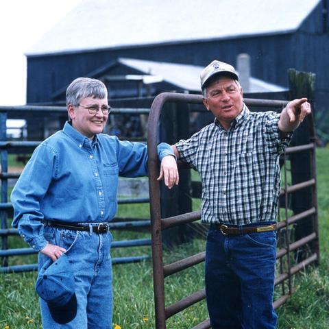 Photo of Deborah Reed in field with farmer