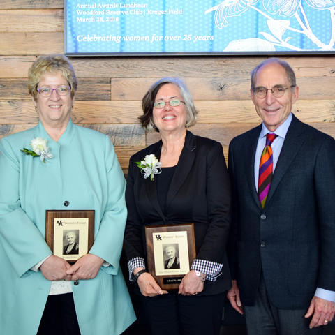 photos of 2018 Sarah Bennett Holmes Award winners Debra Moser and Lisa Collins with President Eli Capilouto.