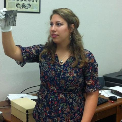 photo of Learning Lab intern in white gloves working with collection at UK Libraries