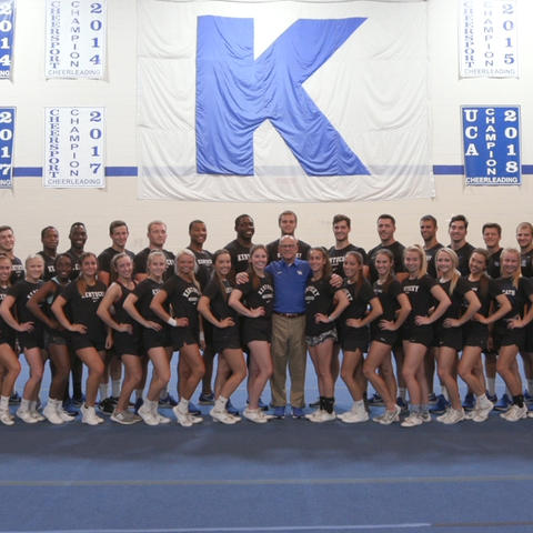 This is a photo of the UK Cheerleading Squad, with T. Lynn Williamson in the middle.