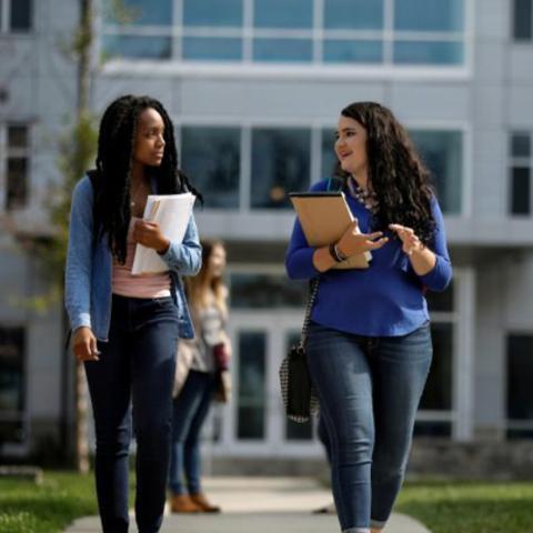 Two girls walking to class.