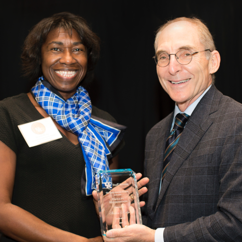 photo of President Capilouto and award winner Sharon Hodge of Social Work
