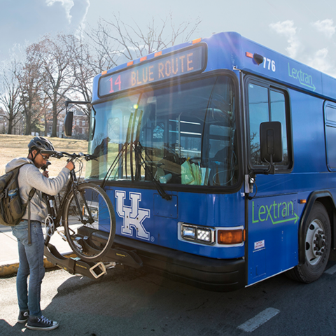Man loading his bike on the bus.