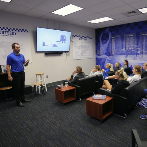 Marc Cormier talking to a group of student athletes. Photo provided by UK Athletics.