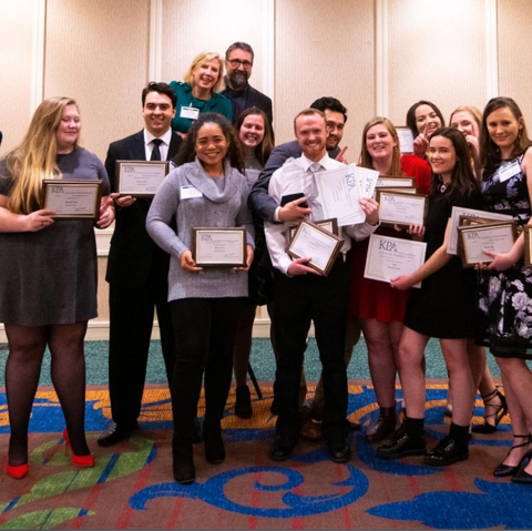 The Kentucky Kernel staff celebrate winning the KPA General Excellence Award for Large Collegiate Papers in January 2020, the last time they were able to celebrate awards together before the pandemic began.