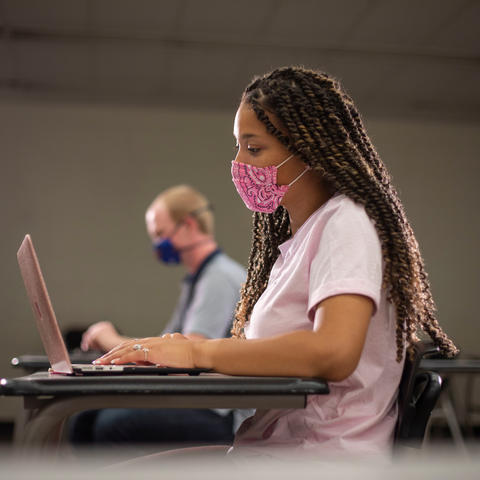 student in class wearing mask