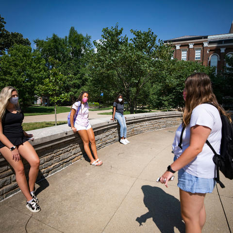 students standing on campus