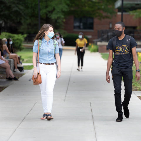 students walking on campus in masks