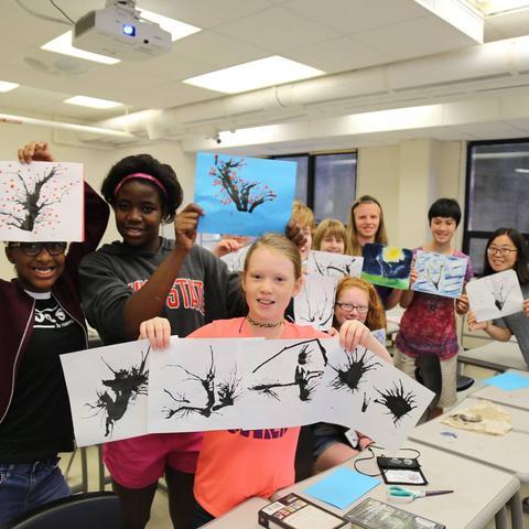 photo of kids with artwork at Confucius Institute summer camp