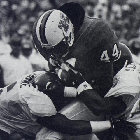photo of Terry Samuels playing football for UK in 1993 from UK Athletics publication