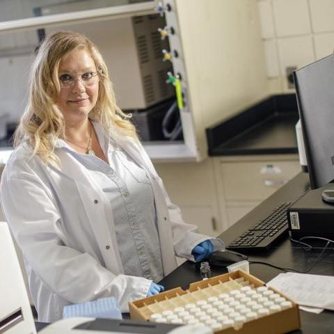 photo of Tiffany Messer standing in lab